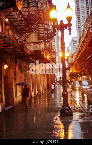 Chicago, United States. 14th Jun,  2017. Someone holds their umbrella close as they bid to get out of the Chicago - Stock Image