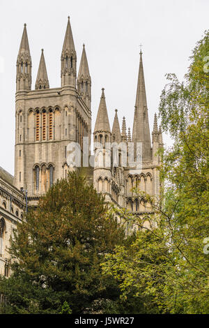Towers and spires at the western end of the medieval christian cathedral at Peterborough, England. - Stock Image