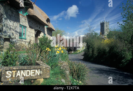 thatched cottages and and All Saints parish church in Godshill, Isle of Wight - Stock Image