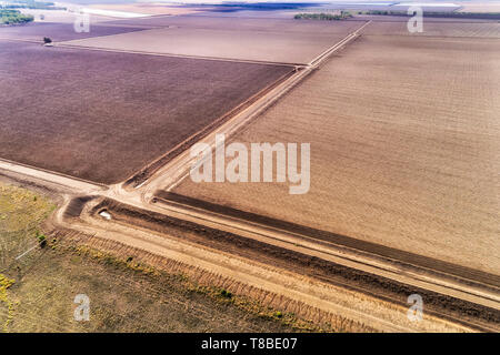 Plowed cultivated farm fields around Moree argicultural town in Australian wheat belt on top of artesian basin in NSW. Aerial elevated view over groun - Stock Image