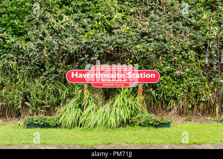 Sign at Haverthwaite railway station in the Lake District. The preserved heritage railway runs for 3.2 miles from Haverthwaite to Winderemere Lakeside - Stock Image