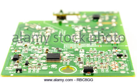 circuit board and electronic parts isolated white background - Stock Image