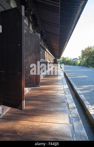 Wood panel temple exterior ancient architecture walkway - Stock Image