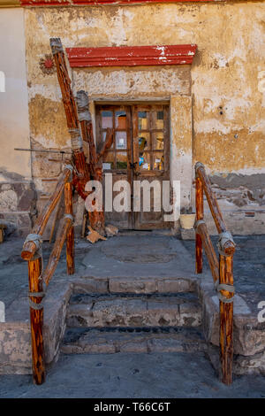 Steps with rustic wood railings leading to a door in Loreto, Baja California Sur, Mexico. - Stock Image