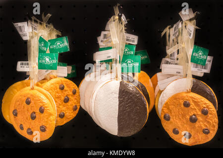 Christmas ornaments in the shape of chocolate chip cookies - Stock Image