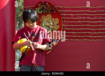 USA, Arizona, Phoenix. Boy winding his Chinese yo-yo. Credit as: Wendy Kaveney / Jaynes Gallery / DanitaDelimont.com - Stock Image