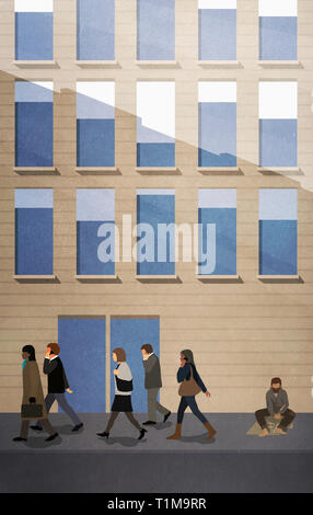 Business people passing homeless man on urban sidewalk - Stock Image