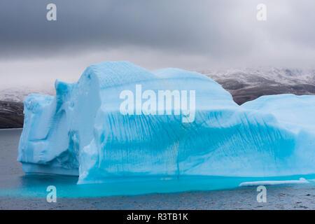 Greenland. Northeast Greenland National Park. Kong Oscar Fjord. Iceberg showing an interesting melting pattern. - Stock Image