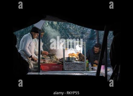 Street market and food stalls in Jemaa el-Fna square in Marrakesh in Morocco. - Stock Image
