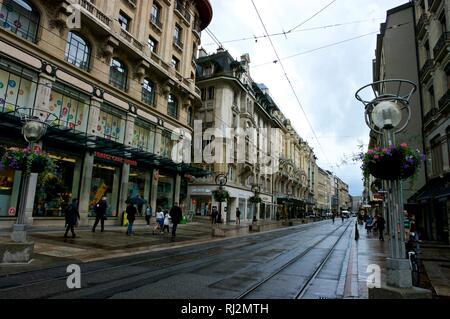 Apartment blocks and commercial buildings in Old Town Geneva Switzerland on rainy day - Stock Image