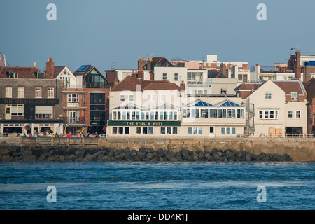 View across the harbour to Old Portsmouth and the two pubs - the Spice Island Inn and Still and West on a warm summers - Stock Image