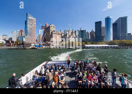 Skyline of Manhattan, New York City, USA from the ferry to Liberty Island - Stock Image