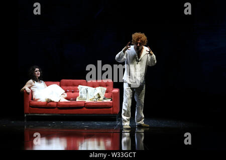 Sydney, Australia. 12th July 2019. Final dress rehearsal of Whiteley, Opera Australia's newly commissioned work about the turbulent life of iconic Australian artist Brett Whiteley and his vivacious wife Wendy. Pictured: Julie Lea Goodwin in the role of Wendy Whiteley and Leigh Melrose in the role of Brett Whiteley on stage at the Joan Sutherland Theatre, Sydney Opera House. Credit: Richard Milnes/Alamy Live News - Stock Image