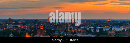 The city of Groningen in the northen part of the Netherlands during blue hour on a summer evening with the view towards the center part of town. - Stock Image