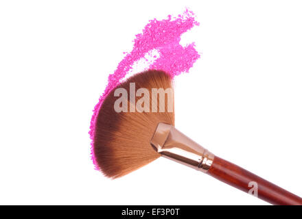 Crisp eyeshadow makeup and brush on a white background - Stock Image