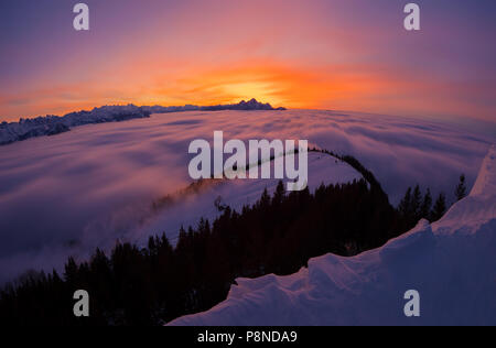 Sunset over clouds - Stock Image