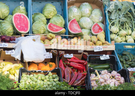 PRAGUE, CZECH REPUBLIC 16-04-2019: Colorful vegetables and fruits in the palets - Stock Image