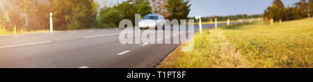 Road panorama on sunny spring evening - Stock Image