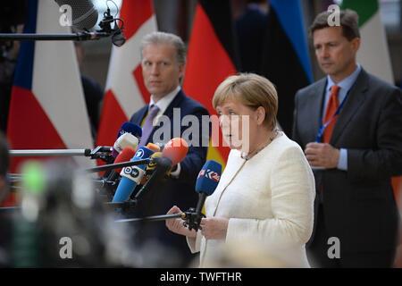 Brussels, Belgium. 20th June, 2019. German Chancellor Angela Merkel speaks to journalists prior to an EU summit, on June 20, 2019, in Brussels, Belgium. Credit: Jakub Dospiva/CTK Photo/Alamy Live News - Stock Image