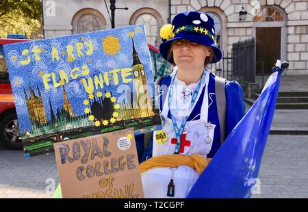 1st Apr 2019. A nurse and  member of the Royal College of Nursing joins the demonstration.Pro and Anti Brexit Protests, Houses of Parliament, Westminster, London. UK Credit: michael melia/Alamy Live News - Stock Image
