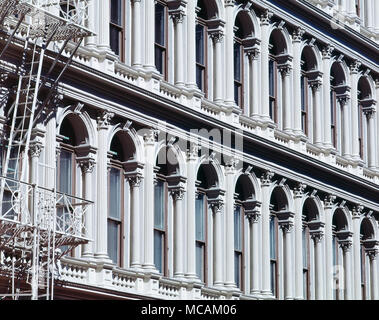 Almost all of SoHo is included in the SoHo-Cast Iron Historic District, which was designated by the New York City Landmarks Preservation Commission in 1973, extended in 2010, and was listed on the National Register of Historic Places and declared a National Historic Landmark in 1978. It consists of 26 blocks and approximately 500 buildings, many of them incorporating cast iron architectural elements. Many side streets in the district are paved with Belgian blocks - Stock Image