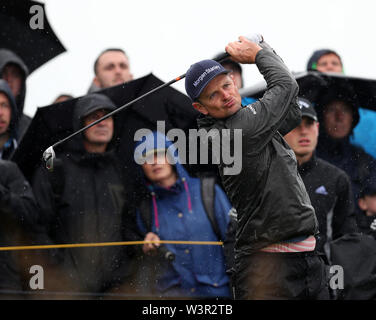 Portrush, County Antrim, Northern Ireland. 17th July 2019. The 148th Open Golf Championship, Royal Portrush Golf Club, Practice day ; Justin Rose (ENG) follows the flight of his tee shot on the 14th hole Credit: Action Plus Sports Images/Alamy Live News - Stock Image