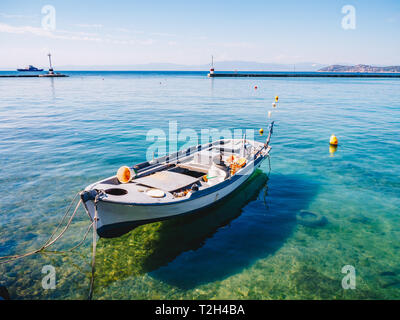 Traditional Fishing boat in harbour on the Greek island Thasos in the Aegean Sea - Stock Image