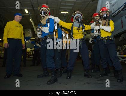 Sailors aboard USS Dwight D. Eisenhower conduct training. - Stock Image