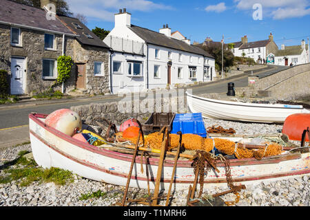 Beached fishing boats and paraphernalia on beach in village of Moelfre, Isle of Anglesey, Wales, UK, Britain - Stock Image