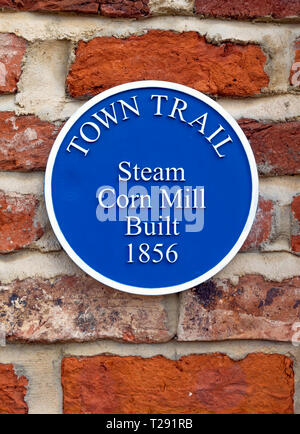 A Blue Plaque marking the Town Trail for the site of the Steam Corn Mill built 1856 in Mill Lane Guisborough North Yorkshire - Stock Image