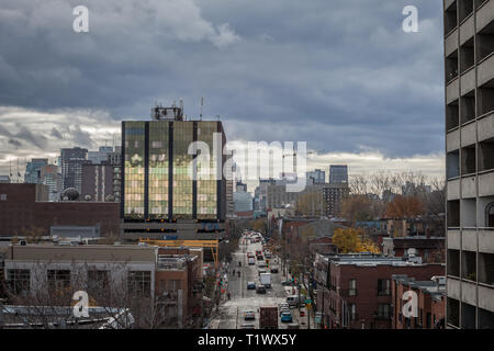MONTREAL, CANADA - NOVEMBER 8, 2018: Skyline of Montreal CBD seen from Le Village district on the De Maisonneuve Boulevard street during a cloudy afte - Stock Image