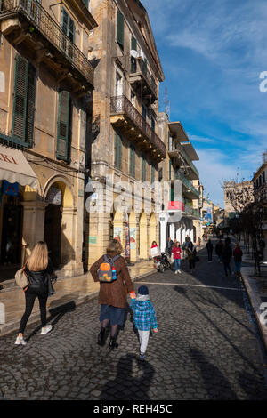Greece Corfu Corfu Town mother and child walking down a cobbled stone street - Stock Image