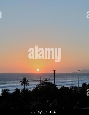 Beautiful sunset at the Barra de Tijuca beach. Rio de Janeiro. Brazil - Stock Image