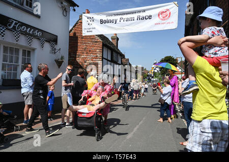 Bolney Sussex, UK. 22nd Apr, 2019. Competitors celebrate finishing the annual Bolney Pram Race in hot sunny weather . The annual races start and finish at the Eight Bells Pub in the village every Easter Bank Holiday Monday Credit: Simon Dack/Alamy Live News - Stock Image