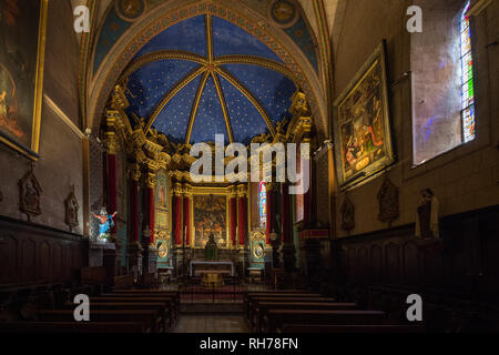 The interior pf the cathedral of Notre Dame de l'Assomption in the medieval town of Entreveux, France - Stock Image