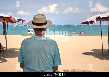 Solitary man overlooking the beach and ocean at Pattaya, Thailand, Southeast Asia - Stock Image