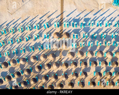Aerial top down view of Marble Beach sunchairs and umbrellas - Stock Image