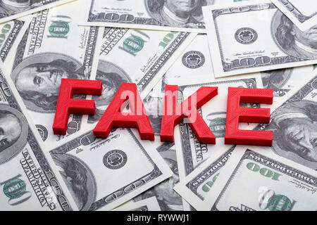 High Angle View Of Red Fake Word On American Banknote - Stock Image
