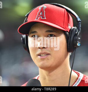 Los Angeles Angels' designated hitter Shohei Ohtani is interviewed after winning the Major League Baseball game against the Minnesota Twins at Oriole Park at Target Field in Minneapolis, Minnesota, United States, May 13, 2019. Credit: AFLO/Alamy Live News - Stock Image