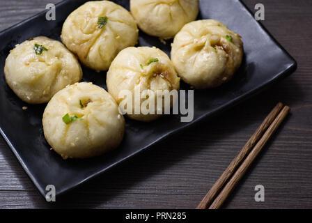 Food pan fried pork bun - Stock Image