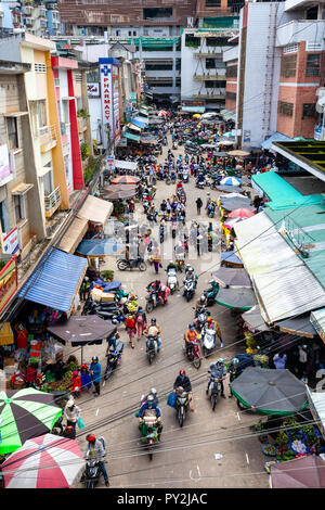 DA LAT, VIETNAM - SEPTEMBER 23: View from above to the traffic jam at the Vietnamese street market on September 23, 2018 in Da Lat, Vietnam. - Stock Image