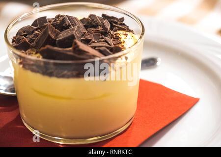 portion of Mascarpone con Scaglie di Cioccolato or Mascarpone cup with chocolate flakes italian traditional dessert - Stock Image