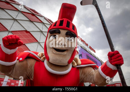 Gladiator - mascot of hockey club 'Spartak' on the background of the facade of the football stadium 'Otkritie Arena' in Moscow, Russia - Stock Image