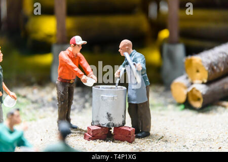 Miniature model of a man dispensing soup at a building site, at Kolejkowo, Wrocław, Wroclaw, Wroklaw, Poland - Stock Image