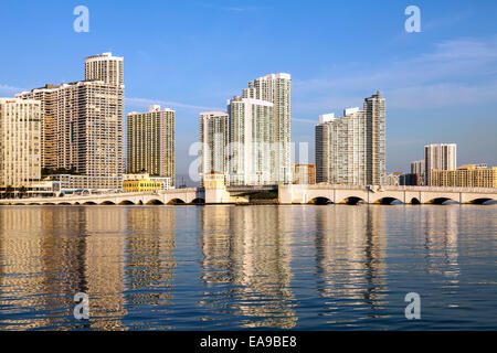 The historic Venetian Causeway bascule bridge arches it's way across Biscayne Bay with the Miami skyline beyond, - Stock Image