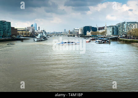 A Thames Clipper boat manoeuvering on the River Thames in London. - Stock Image