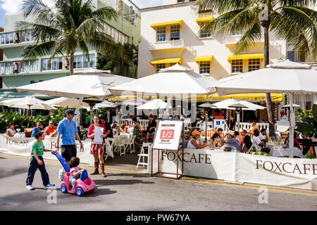 Miami Beach Florida Ocean Drive New Year's Day Art Deco District Fox Cafe restaurant umbrellas alfresco al fresco dining diner - Stock Image