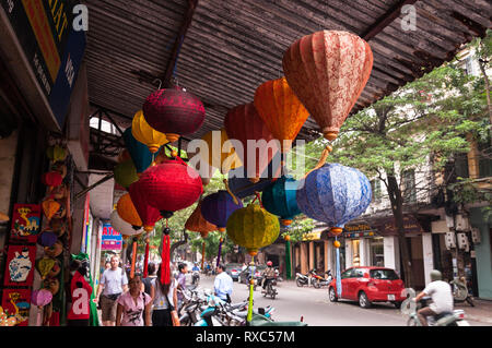 Several colourful handmade lampshades or lanterns hanging outside a shop, Hanoi, Vietnam - Stock Image