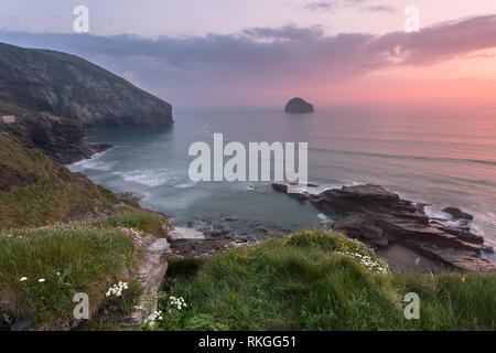 Sunset from Trebarwith strand in early summer Cornwall Uk - Stock Image