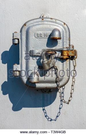 Padlock on locked metal box at railroad level crossing. - Stock Image